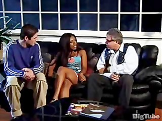 an ebony chick gets a facial from a white guy
