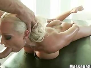 nice-looking blond diana engulfing her masseurs