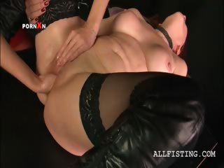 lesbian aged in nylons acquires fist fucked