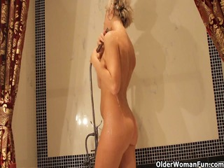 hot mature mommy takes a washroom and masturbates