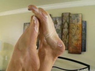 super titted wife gives a astounding footjob