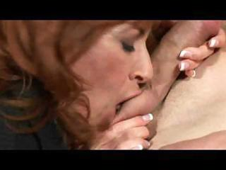 breasty milf mikela sinuates on a table during