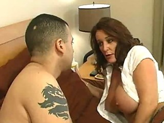 Mature slut with big tits gets a bedroom milf