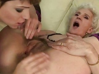 granny enjoys lesbo sex with youthful girl