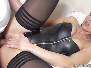 ass screwed in a dark leather corset and stockings