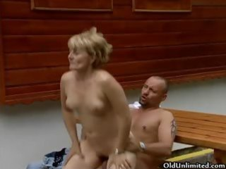 naughty golden-haired older woman gets her fur pie