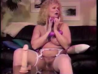 breasty older blonde shablee plays with toys in