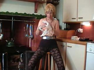 british blond aged does a striptease and toys her