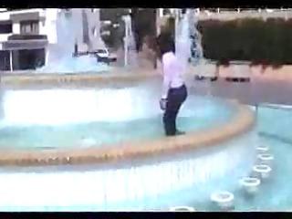 marjorie is getting wet in a public fountain -