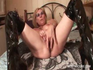 mature in latex boots masturbating slit with
