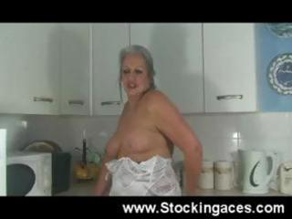 aged ladies bonks her cunt in the kitchen