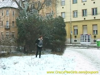 breasty mom peeing in snow